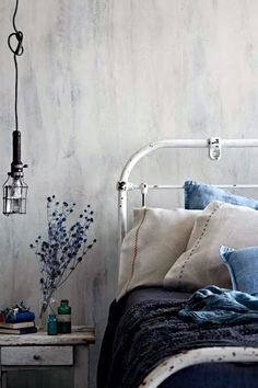 Beautiful #IndigoBlue Whitewashed painted Wall. Shades of Blue. Great wall finish. Drag white paint over a blue wall. Old Iron bed with Indigo bedding. Shabby Chic. #RomanticBedroom. This looks like the perfect bedroom for a Cowgirl. Rustic Charm Bedroom.
