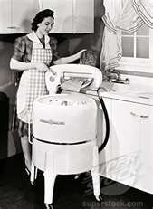 my mother used to do the laundry this way - I was so sad when she traded it in for an automatic machine. I loved washing my doll clothes in it, loved helping her put things through the ringer. THAT made mom a nevous wreck