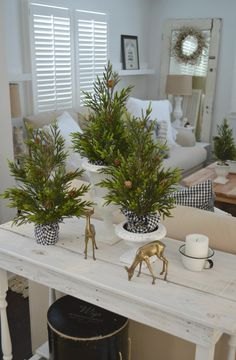 Cozy Cottage Farmhouse Winter Decorating Ideas - HomeGoods has the most darling mini trees that transition perfectly from holiday to the Winter season, and I paired them with a set of vintage brass dear. #sponsored pin