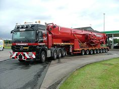 MBZ tractor hauls in the Mammoet crane boom section.......