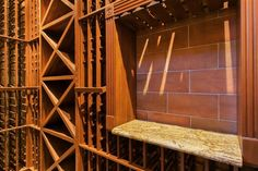 Traditional Wine Cellar with High ceiling, Built-in bookshelf, Vinogrotto Wine Racks and Cellar Systems