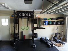 Great utilization of space in this homemade garage gym complete with rubber bands wall balls and foam rollers - Tap the pin if you love super heroes too! Cause guess what? you will LOVE these super hero fitness shirts!