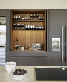 Walnut veneer interior of the #bulthaup pocket door with soft touch 'Lava'… prachtig van binnen afgewerkte kast