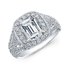 An intricately woven design is micro pave set with one hundred and thirty-four diamonds weighing 0.97cts and  holds a delicate center halo mounting made for an 2 Carat emerald Cut center in this beautiful Natalie K engagement ring.
