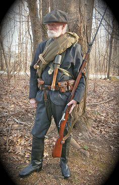 Shelterhalf wrapped blanket roll, German grenade and bayonet, Russian ammo pouches and Mosin Nagant 91/30 rifle and bayonet