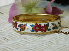 Hey, I found this really awesome Etsy listing at https://www.etsy.com/il-en/listing/291292689/vintage-cloisonne-bracelet-gold-metal