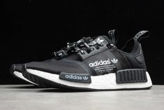 The adidas NMD_R1 Logo is another lifestyle shoe that follows the logo-mania trend. This adidas NMD features a Black mesh upper highlighted with branded laces and a large logo over the Three Stripes. A full-length White Boost midsole, Black EVA insert overlays atop a matching Black rubber outsole completes the design. Adidas Nmd_r1, Adidas Logo, Adidas Sneakers, Nmd R1, Black Brick, Black Laces, Black Mesh, Black Rubber, Classic Looks