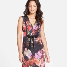 """Floral Sheath with Bow A delightful black with multi flowered sheath with decorative side plackets on the bodice and a faille bow. Fully lined, invisible zipper, 100% poly. This dress comes in two sizes, measurements for an Adrianna Papell 12; bust 39"""", waist 31"""", hips 41"""". Sizing for an 8; bust 36.5, waist 28.5"""", hips 38.5"""". Length approximately 39"""". Additional pics and questions answered upon request. Adrianna Papell Dresses"""