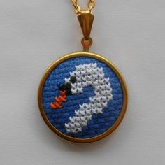 Pretty cross stitch swan necklace in royal blue on by MaMagasin, £14.00