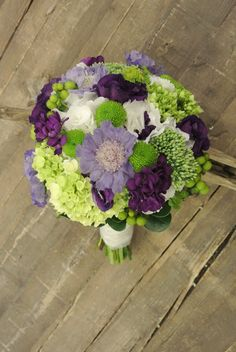 Purple and green bridal bouquet with hydrangea,scabiosa,spray mum,lisianthus,hypericum
