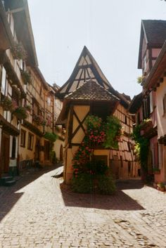 A village along the Route des Vins of Alsace. Anywhere flowers could be planted, they grew. Colorful half-timbered houses with windows that overflowed with geraniums, and along the cobblestone streets, ancient church bells ringing daily at noon, and castles looking over every village.
