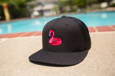 Add some tropical vibes to your summer with a custom pink flamingo pool float hat. Design your own at Lids Custom Zone.
