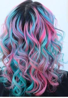 Love this pink and blue hair. The curls really make the color pop. #hairstyles #pinkhair #bluehair #dyedhair #haircolors
