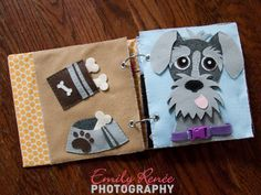 Animal quiet book with movable dog bones and schnauzer wearing buckled collar emilyreneephoto.com