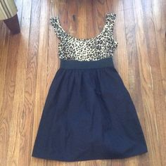 Xhilaration leopard print dress Size small. No tags, but I don't believe this was ever worn. In new condition. Top: 95% cotton and 5% spandex. Bottom: 100% cotton. Great paired over black tights! Feel free to ask me any questions😊 Xhilaration Dresses