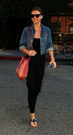 Miranda Kerr topped off a long black tank dress with this classic Levi's jacket.