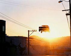 Old Muscle Cars Racing Through the Sky - My Modern Metropolis