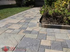 Olsen Infinity Skifer Pavers natural stone finishes brings both softness and depth to your landscape.