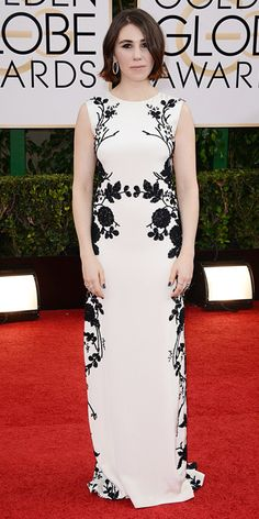 Graphic Black and White Gowns - Zosia Mamet wore a sleek, white column Reem Acra gown that was adorned with black flower detailing that she topped off with freshly-shorn locks