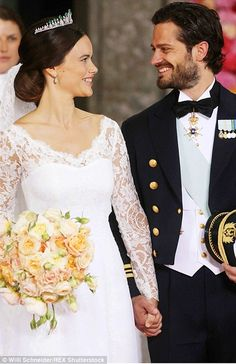 First kiss: The couple share a kiss after tying the knot at the lavish ceremony in Stockholm that was attended by royals around the world