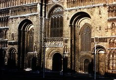 ROMANESQUE ARCHITECTURE, England - Lincoln cathedral, begun 1073. Anglo-Norman great churches were generally tall, carefully-articulated structures, with a three-part nave elevation that often included a large tribune gallery vaulted in stone. Lincoln is unique in Norman architecture. Its patron, Bishop Remigius, came from Fécamp in Normandy. The westwork of the cathedral reflects the French Romansque architecture.