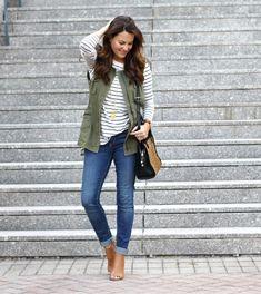 Cute fall outfit idea. Military vest, denim, striped tunic and peep toe boots via Peaches In a Pod blog.