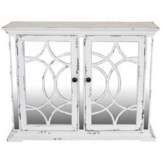 Rachel Distressed wood two-door cabinet with lattice overlay. Material: Wood and mirror.  Finish:  Antique White