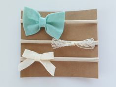 The Tiffany set comes with one Tiffany blue felt bow, one lace bow and one Ivory bow all placed on nylon headband or clips. Please leave a note in checkout with clip or headband choice. All ite...