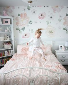 One little monkey jumping on the bed! Our Jolie Mural pairs so well in this little girls room, we're loving all those pastel pinks! Big Girl Bedrooms, Little Girl Rooms, 4 Year Old Girl Bedroom, Shared Bedrooms, Girls Bedroom Wallpaper, Little Girl Wallpaper, Toddler Rooms, Girl Toddler Bedroom, Girls Flower Bedroom