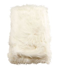 White furry blanket - as a bedroom, lounge or ottoman throw.