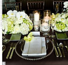 Bold centerpieces of cymbidium and phalaenopsis orchids, calla lilies, anthurium, roses, and hydrangeas lined the banquet-style table. Glass chargers with silver pearls sat atop rich chocolate-brown linens.