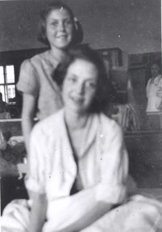 Bergen Belsen, Germany, The fourteen year old Hannah Sachsel with her sister Eva (in the back) in the camp hospital, 1945. Hannah and Eva arrived to the camp from Czechoslovakia. Hannah died of Typhus shortly after the photograph was taken.