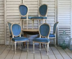 I'm loving these vintage Louis XVI style chairs upholstered in the original blue velvet