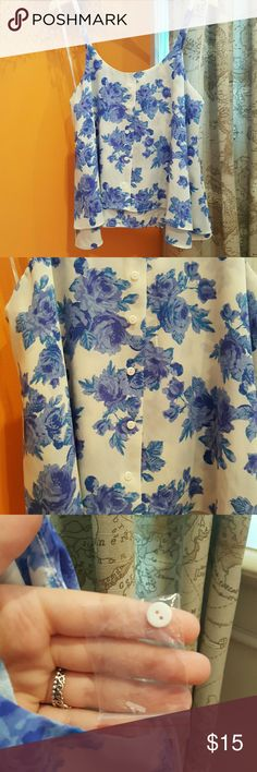 Button up flower blouse Spaghetti strap button up flower blouse. Purchased from Marshalls and never worn. Without tags. Very loose fitting and flowy style. Thin material, all polyester. Has two layers. Extra button comes with it. Paper Crane Tops Blouses