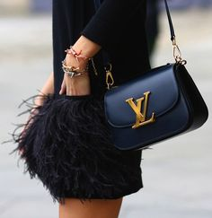 Feathers and leather. louisvuitton