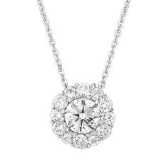 Halo diamond pendant, 1/3 carat total weight, in 14K white gold. Delicate 18 inch chain included.
