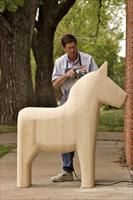 Dala carver  What is a Dala horse?  Its perhaps Sweden's best known icon, a bluntly rounded, tail-free horse that is thought to have been first whittled out of wood by the fire during long cold Scandinavian nights. In recent years, Lindsborg adopted the Dala symbol of Swedish folk craft as a symbol of identity and welcome. Here you'll see traditional Dala horses on front porches, on coffee mugs and even on the side of police cruisers.