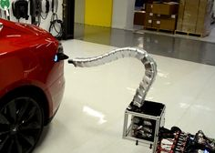 Tesla's robo-snake charger prototype is our new car overlord