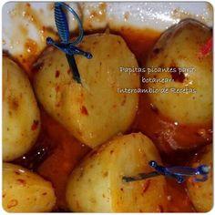 Papitas picantes para botanear 1kg de papa cambray (la blanca chica) El jugo de 5 limones Aceite de oliva (la misma cantidad que salga de jugo de limón) 5 dientes de ajo 10 chiles de àrbol 2 cucharadas de consomé de pollo Se cuecen las papas. En la licuadora echar todos los ingredientes menos las papas y después calentar, cuando ves que cambia de color bajarle al fuego y sancochar las papitas. listo a disfrutar.