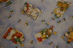 Snow Flurries Tossed Snowmen Motif (Light Blue background); sold by the yard