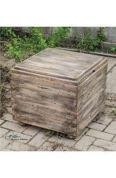 DIY? Weathered pallet wood storage cube? Could upholster top?