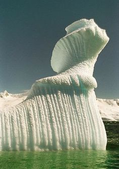 Spiral iceberg in Antarctica *tilts head like cornfused husky* how'd that happen???