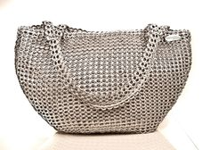My favorite bag on the planet! Everyone always asks what its made from and where i got it. Here it is! ecochicc — A-CDLP 06 Boat Bag made from handmade recycled aluminum pop top pull tabs