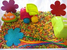Fruit Loop Sensory Bin - so much fun and it doesn't matter if it lands up in your baby's mouth! How better to encourage your little one's fine motor skills.