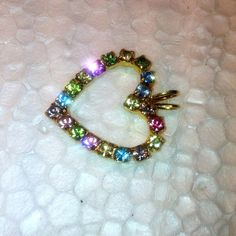 Vintage rainbow of colored prong set rhinestones by jewelry715, $10.00