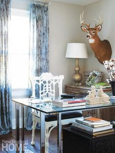 A glass-topped desk has plenty of space for spreading out papers.  Interior design by Gina Eastman, photography by John Gruen Natural Wonder | New England Home Magazine