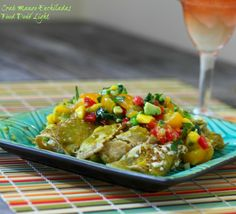 Try these light Crab Mango Enchiladas.  Whip up some margaritas and have a Fiesta.  Food Done Light #lightenchiladas #crabenchiladas #enchiladas