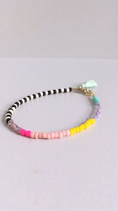 Excited to share this item from my shop: Single Zebra bracelet - Czech glass beads - friendship bracelet - geometric - by STICKTAILS Diy Friendship Bracelets With Beads, Diy Beaded Bracelets, Beaded Choker Necklace, Bracelet Crafts, Diy Necklace, Handmade Bracelets, Handmade Jewelry, Seed Bead Jewelry, Cute Jewelry