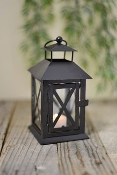Light the way with this darling little lantern. The Metal Lantern measures tall and has a latched door at the front you can open to place a battery operated tealight inside. Use several of these small lanterns at your wedding and hang them from stan Cheap Lanterns, Cheap Candles, Small Lanterns, Metal Lanterns, Candle Lanterns, Top Wedding Trends, Wedding Ideas, Wedding Reception, 2017 Wedding