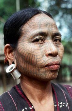 Asia   Portrait of a Chin woman with facial tattoos and earplugs, Arakan, Myanmar   © Richard K Diran #tattoo #piercing